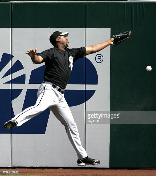 Chicago White Sox RF Jermaine Dye jumps but can't come up with this flyball in Cactus league action in Tempe Arizona March 8 2006