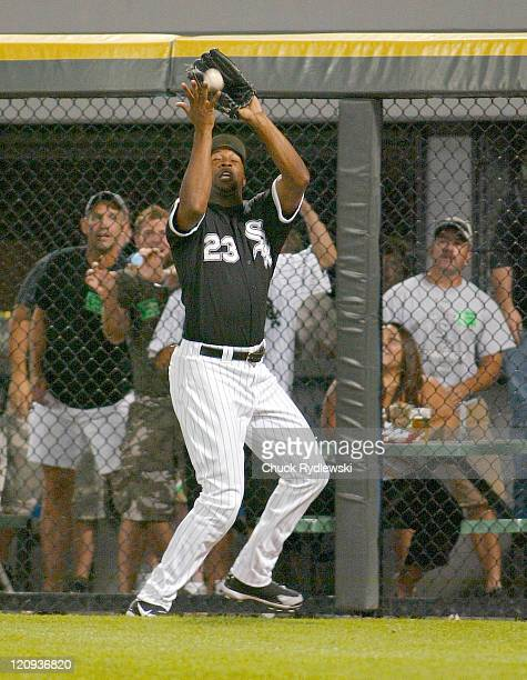Chicago White Sox' Right Fielder Jermaine Dye drops Angel Berroa's fly ball for a threebase error during their game against the Kansas City Royals...