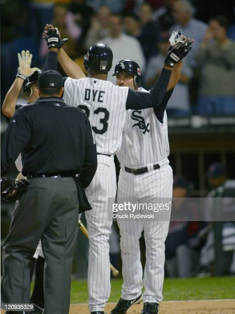 Chicago White Sox Right Fielder Jermaine Dye is greeted at home plate by Paul Konerko following his 3 run 2nd inning home run during the game against...