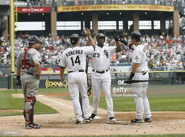 Chicago White Sox' Right Fielder Jermaine Dye is greeted at home plate after homering during the game against the Minnesota Twins July 26 2006 at US...