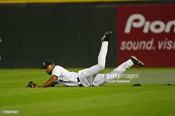 Chicago White Sox Right Fielder Jermaine Dye makes a diving catch during the game against the Cleveland Indians September 20 2005 at US Cellular...