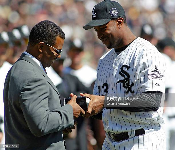 Chicago White Sox right fielder Jermaine Dye right presents General Manager Kenny Williams with his World Championship ring prior to the game between...
