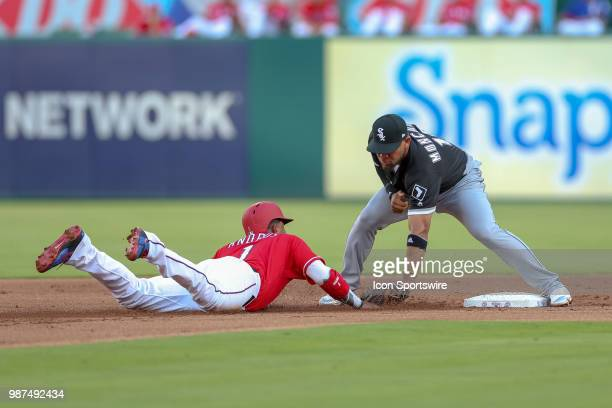 Chicago White Sox Second base Yoan Moncada tags out Texas Rangers Shortstop Elvis Andrus during the game between the Chicago White Sox and Texas...