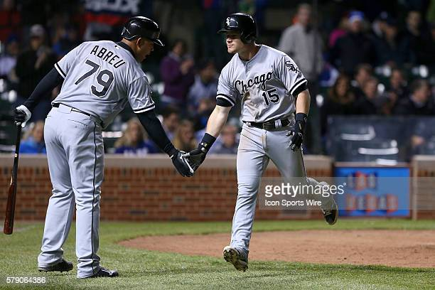 Chicago White Sox second baseman Gordon Beckham celebrates with Chicago White Sox first baseman Jose Abreu after hitting a single home run in the 8th...