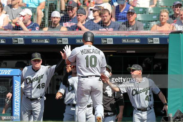 Chicago White Sox second baseman Yoan Moncada is congratulated by Chicago White Sox assistant hitting coach Greg Sparks and Chicago White Sox bench...