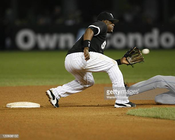 Chicago White Sox short stop Juan Uribe prepares to tag a base stealing B J Upton during game action at US Cellular Field Chicago Illinois on August...