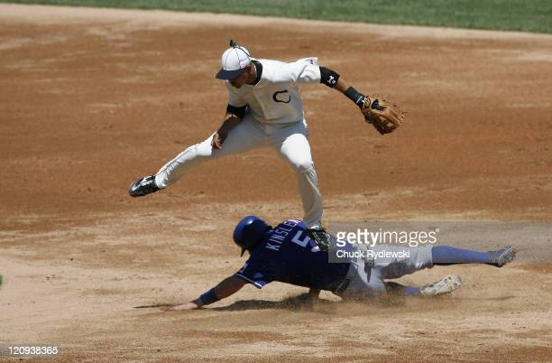 Chicago White Sox' Shortstop Alex Cintron leaps to avoid a sliding Ian Kinsler and turns a double play during the game against the Texas Rangers July...