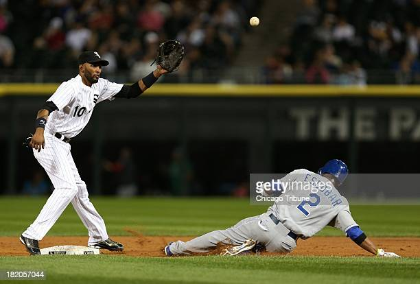 Chicago White Sox shortstop Alexei Ramirez takes a late throw as the Kansas City Royals' Alcides Escobar steals second base in the second inning at...
