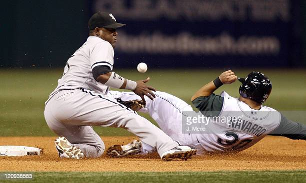Chicago White Sox shortstop Juan Uribe cannot handle the throw as Tampa Bay Devil Rays catcher Dioner Navarro slides safely into second on Monday...
