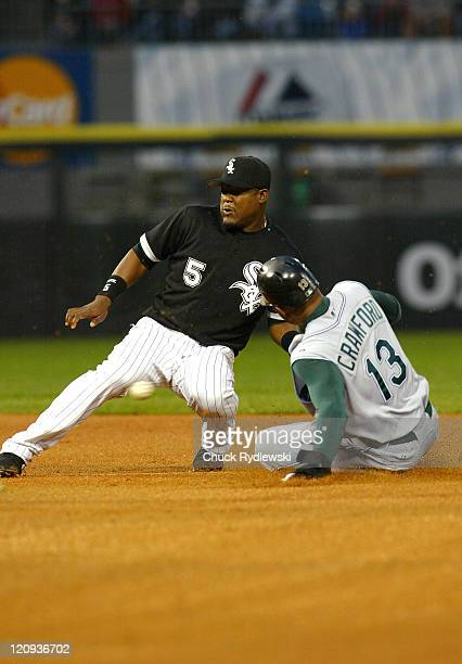Chicago White Sox' Shortstop Juan Uribe can't come up with the throw as Carl Crawford steals 2nd base during their game against the Tampa Bay Devil...