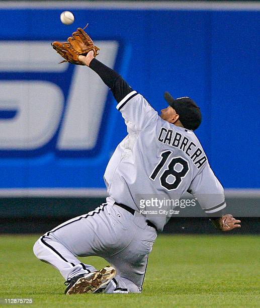 Chicago White Sox shortstop Orlando Cabrera makes a catch going away from him for an out on Kansas City Royals' Mark Teahen in the fifth inning at...