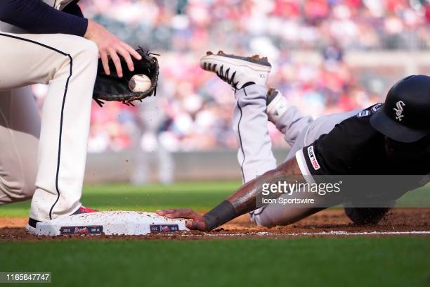 Chicago White Sox Shortstop Tim Anderson dives back to first base safely during the MLB game between the Atlanta Braves and the Chicago White Sox on...