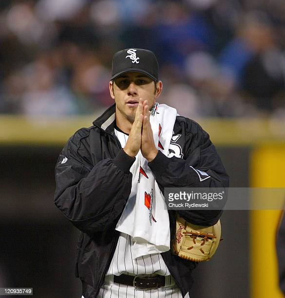 Chicago White Sox' Starter Jon Garland tries to keep warm prior to the start of their game against the Kansas City Royals May 5, 2006 at U.S....