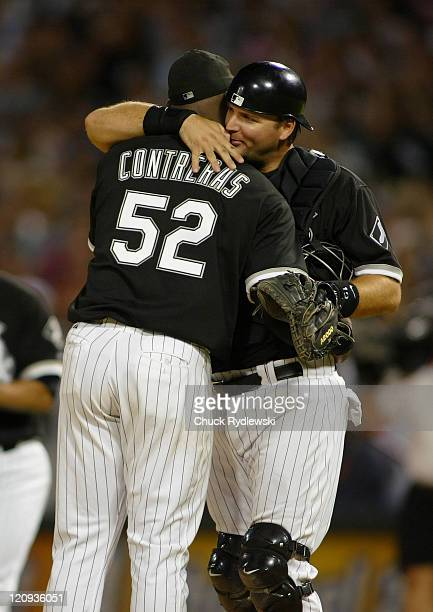 Chicago White Sox' Starter Jose Contreras gets a big hug from his Catcher AJ Pierzynski after shutting out the Detroit Tigers August 11 2006 at US...