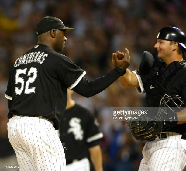 Chicago White Sox' Starter Jose Contreras is greeted by Catcher AJ Pierzynski after shutting out the Detroit Tigers 50 August 11 2006 at US Cellular...