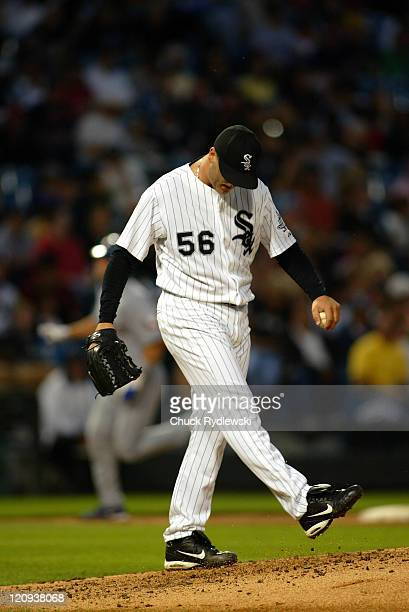 Chicago White Sox' Starter Mark Buehrle paws the dirt after giving up a 3run homer to the Texas Rangers' Michael Young during the game against the...