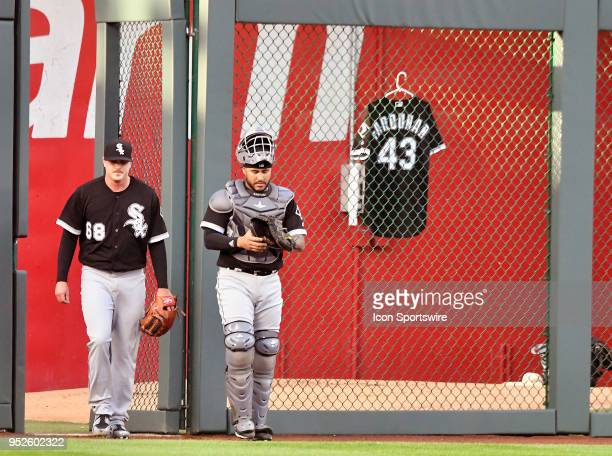 Chicago White Sox starting pitcher Dylan covey and Chicago White Sox catcher Omar Narvaez come in from the bull pen as a jersey dedicated to White...