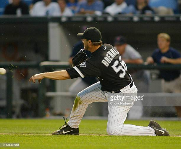 Chicago White Sox Starting Pitcher Mark Buehrle fields a bunt and throws to 1st base to get the hitter during the game against the Minnesota Twins...