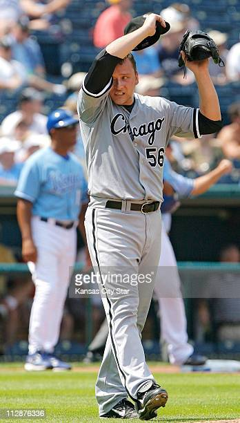 Chicago White Sox starting pitcher Mark Buehrle wipes the sweat from his face as he heads back to the mound in a tworun second inning against the...