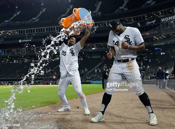Chicago White Sox third baseman Jose Rondon dunks Chicago White Sox left fielder Eloy Jimenez with ice water after getting the win against the...