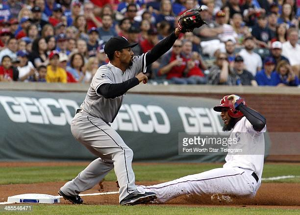 Chicago White Sox third baseman Marcus Semien waits for the throw as the Texas Rangers' Elvis Andrus right reaches third base in the first inning at...