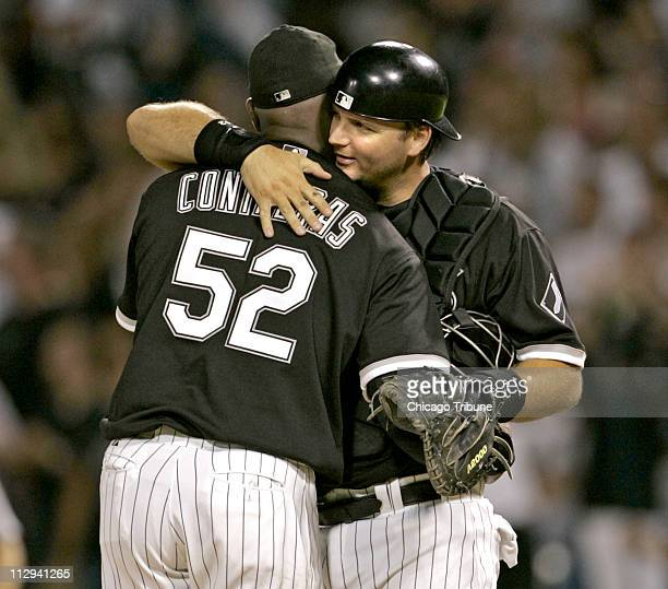 Chicago White Sox's pitcher Jose Contreras gets a hug from catcher AJ Pierzynski after he tossed a threehit shutout to beat the Tigers 50 at US...