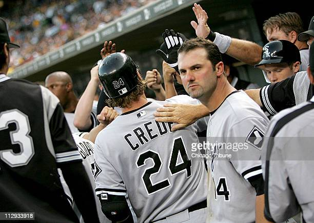 Chicago White Sox's players congratulates Joe Crede after he and Paul Konerko hit solo home runs The White Sox defeated the Tigers 71 at Comerica...