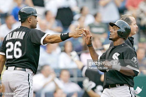 Chicago White Sox's Sandy Alomar Jr and Pablo Ozuna congratulate each other after both scored on a single by Joe Crede in the third inning at...