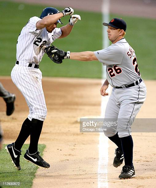 Chicago White Sox's Scott Podsednik gets tagged by the Detroit Tigers' first baseman Chris Shelton in the second inning at US Cellular Field in...