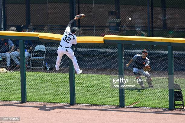 Chicago White Sox's Trayce Thompson climbs the fence attempting to catch the home run ball hit by Detroit Tigers on June 16 2018 at at Guaranteed...