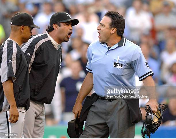 Chicago White Sox's umpire Ozzie Guillen and home plate umpire Phil Cuzzi have a shouting match after Guillen was ejected for arguing balls and...