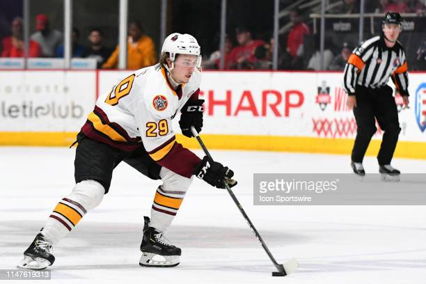 Chicago Wolves center Cody Glass brings the puck up the ice during game one of the Calder Cup finals between the Chicago Wolves and the Charlotte...