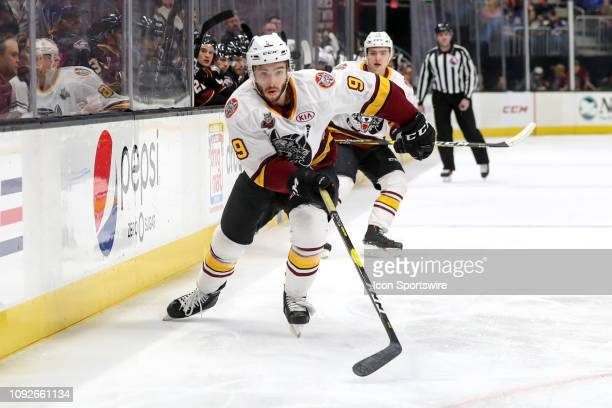 Chicago Wolves center Gage Quinney folows the puck into the corner during the first period of the American Hockey League game between the Chicago...