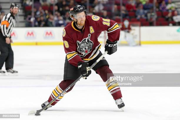 Chicago Wolves center TJ Tynan shoots the puck during the third period of the American Hockey League game between the Chicago Wolves and Cleveland...