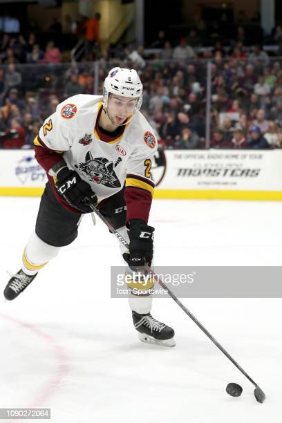 Chicago Wolves defenceman Nic Hague plays the puck during the second period of the American Hockey League game between the Chicago Wolves and...