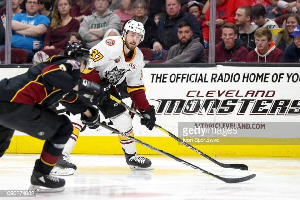 Chicago Wolves defenceman Zac Leslie looks to shoot as Cleveland Monsters defenceman Ryan Collins defends during the third period of the American...