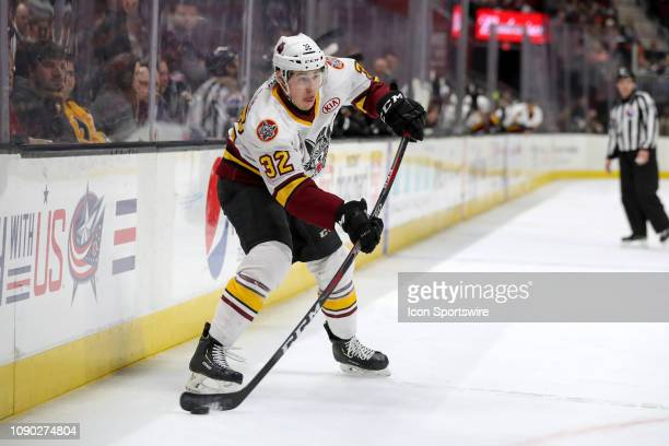 Chicago Wolves defenceman Zach Whitecloud passes the puck during the third period of the American Hockey League game between the Chicago Wolves and...