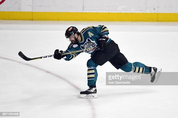 Chicago Wolves defenseman Morgan Ellis takes a shot during an AHL hockey game between the Chicago Wolves and Grand Rapids Griffins on March 18 at the...