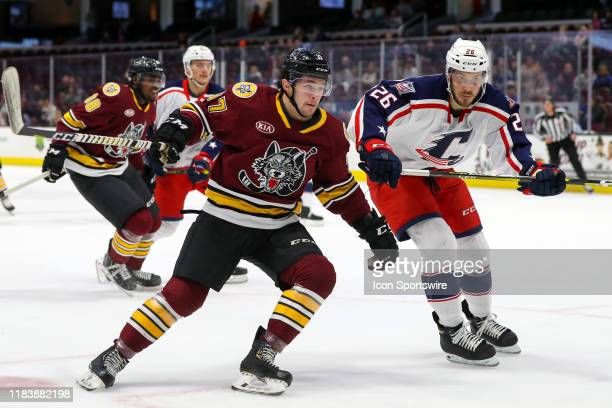 Chicago Wolves forward Paul Cotter is defended by Cleveland Monsters defenceman Doyle Somerby during the first period of the American Hockey League...