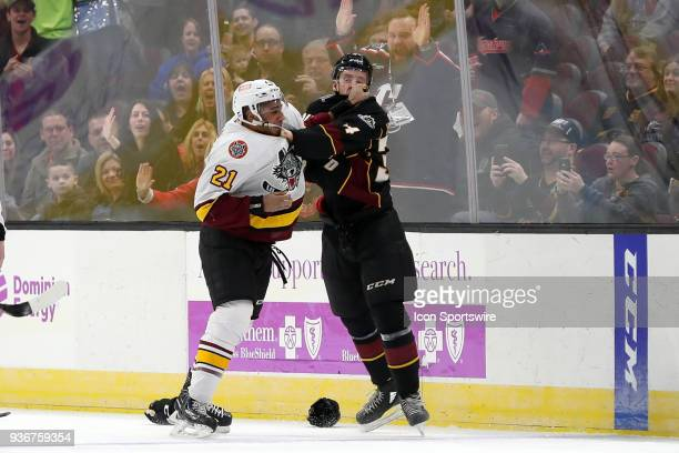 Chicago Wolves forward Scooter Vaughan and Cleveland Monsters defenceman Jacob Graves fight during the third period of the American Hockey League...