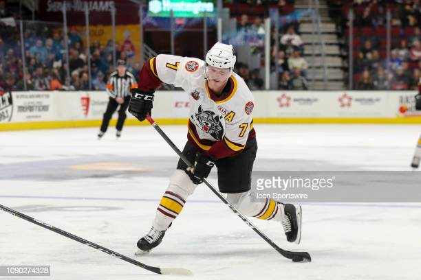 Chicago Wolves left wing Daniel Carr shoots the puck during the second period of the American Hockey League game between the Chicago Wolves and...