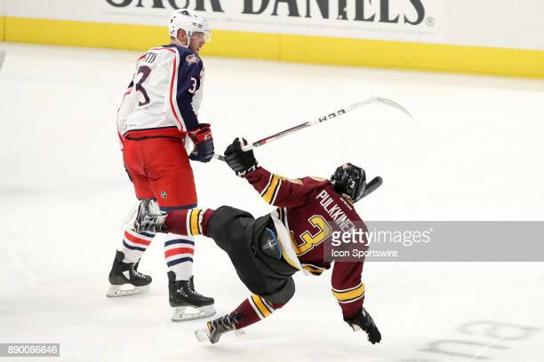 Chicago Wolves left wing Teemu Pulkkinen hits the ice after a collision with Cleveland Monsters defenceman Brady Austin during the third period of...