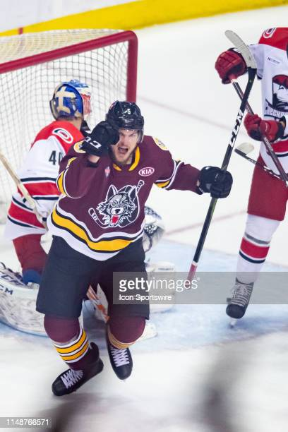 Chicago Wolves left wing Tye McGinn and Chicago Wolves center Cody Glass celebrate a goal during game four of the AHL Calder Cup Finals between the...