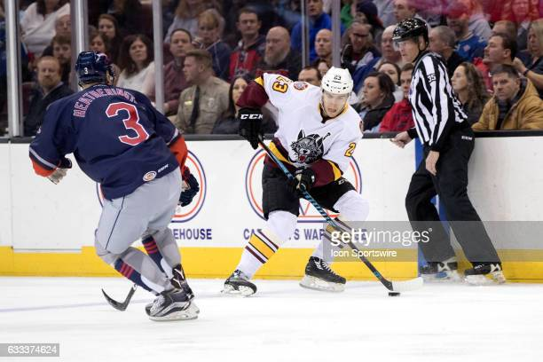 Chicago Wolves LW Magnus Paajarvi is defended by Cleveland Monsters D Dillon Heatherington during the first period during first period of the AHL...