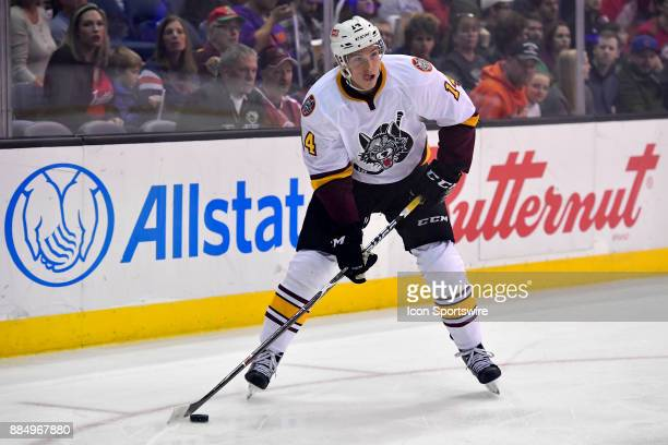 Chicago Wolves right wing Beau Bennett looks to pass the puck during the game between the Chicago Wolves and the Grand Rapids Griffins on December 2...