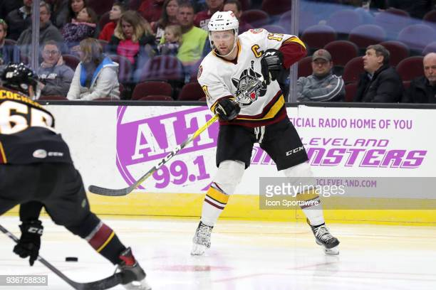 Chicago Wolves right wing Paul Thompson passes the puck during the third period of the American Hockey League game between the Chicago Wolves and...
