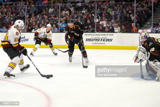 Chicago Wolves right wing Tomas Hyka prepares to shoot against Cleveland Monsters goalie Matiss Kivlenieks during the third period of the American...