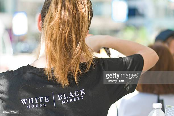 Chicagoans attend the White House Black Market PopUp Studio at Pioneer Court/Tribune Tower on September 5 2014 in Chicago Illinois