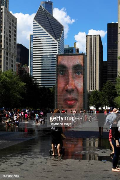 Chicagoans enjoy a warm summer afternoon at Jaume Plensa's 'Crown Fountain' sculpture in Millennium Park in Chicago Illinois on June 24 2017