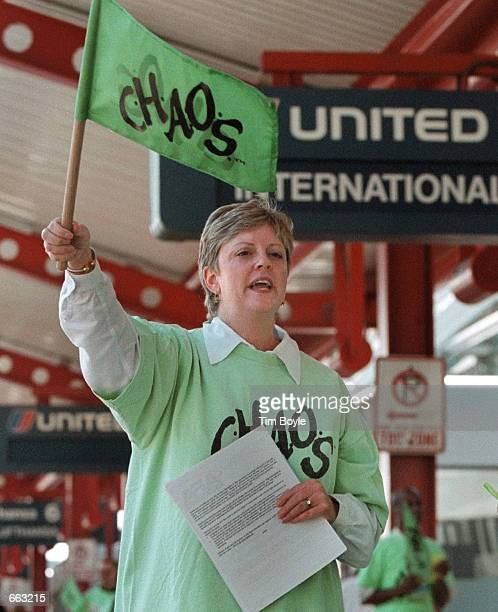 Chicagobased United Airlines flight attendant Dona Miller waves her 'CHAOS' flag as she marches at Chicago's O''Hare International Airport September...